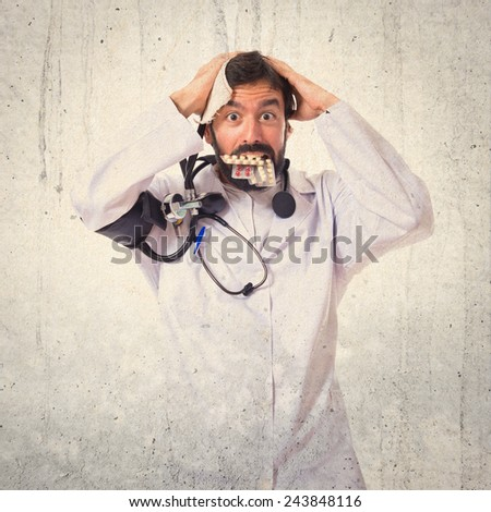 Crazy doctor over textured background - stock photo