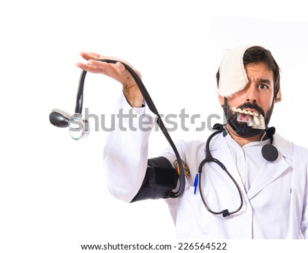 Crazy doctor over white background - stock photo