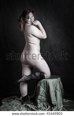 Crazy fat woman. Humorous studio shot. Great for calendar. - stock photo