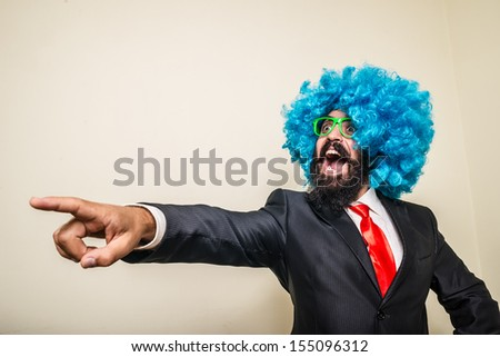 crazy funny bearded man with blue wig on white background - stock photo