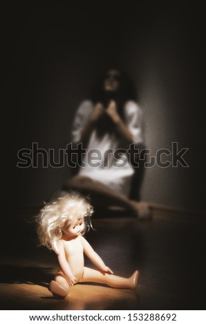 Crazy girl and plastic doll on the floor (ancient style version) - stock photo