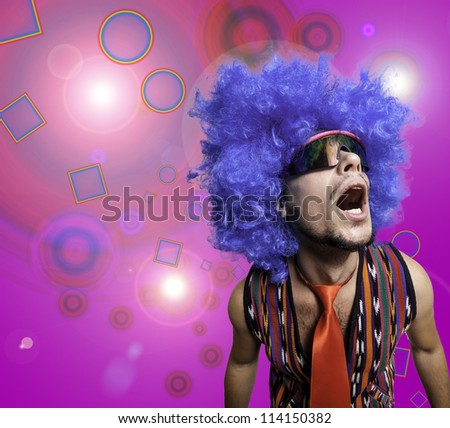 crazy guy with sunglasses and blue wig on colorful background