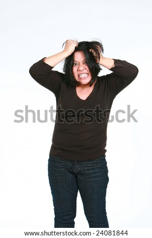 crazy hispanic woman making a face and pulling hair