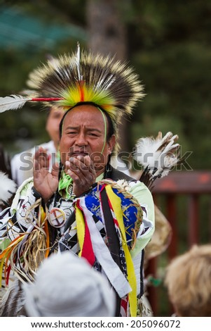 Crazy Horse Memorial, South Dakota  - June 15 : Native American performing for a crowd in the Black HIlls, June 15 2014 in the Crazy Horse memorial, South Dakota