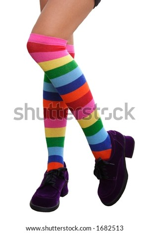 Crazy Legs.  Pretty legs in a crazy comination of multi-colored striped knee-his & chunky purple suede shoes. - stock photo
