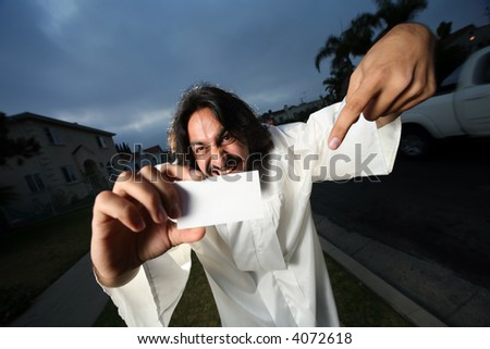 Crazy looking man showing his blank business card.