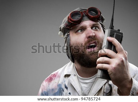 Crazy man communicating on walkie-talkie - stock photo