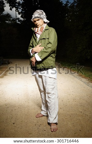 Crazy man in park - stock photo