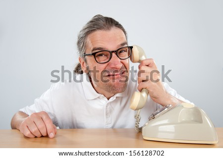 crazy man with telephone  - stock photo