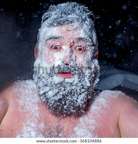 Crazy Russian man ran out of the bath in the snow - stock photo