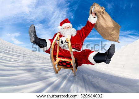crazy santa claus on his sleigh hilarious fast funny crazy xmas christmas gift present delivery blue sky background