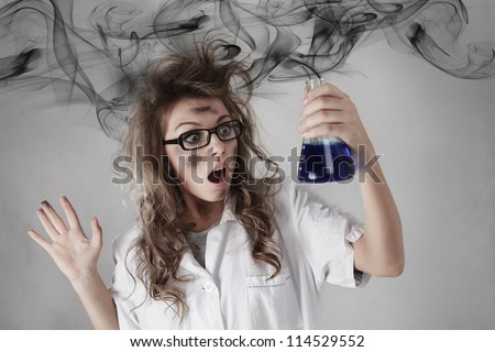 Crazy scientist made a dangerous mistake in scientific chemical experiment - stock photo
