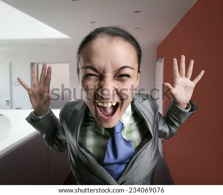 Crazy, shouting woman in the office - stock photo