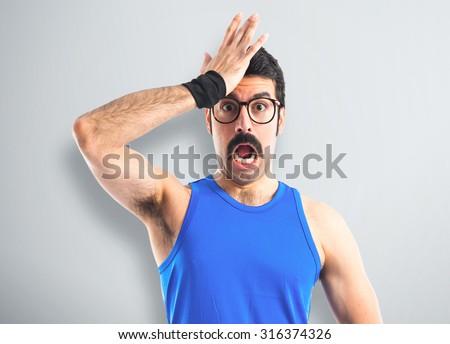 Crazy sportman doing surprise gesture  - stock photo