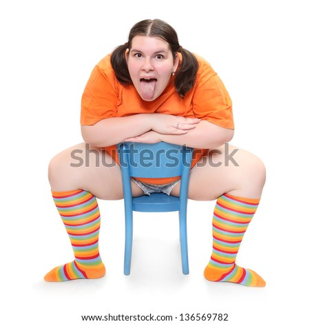 Crazy teenager on a blue chair. Behavioral disturbance in the pubescence. - stock photo