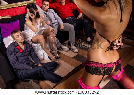 Crazy wedding party in night club. - stock photo