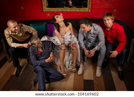 Crazy wedding party in night club. Friends of groom make a drunkard of bride - stock photo