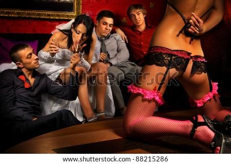 Crazy wedding party in strip club - stock photo