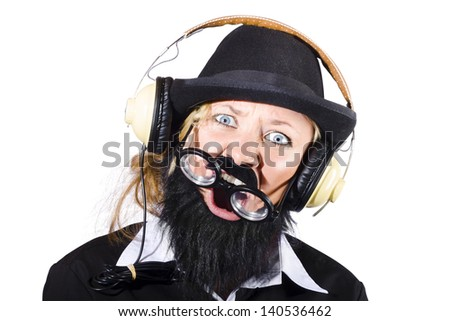 Crazy woman disguised as man with beard and hat wearing headphones, Mad about metal music \m/ - stock photo