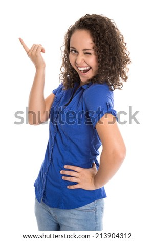 Crazy young girl in blue showing something with her forefinger over white background. - stock photo
