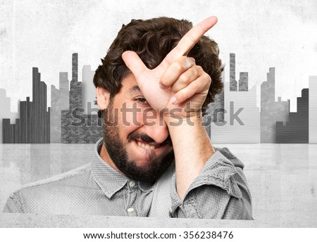crazy young man loser sign - stock photo