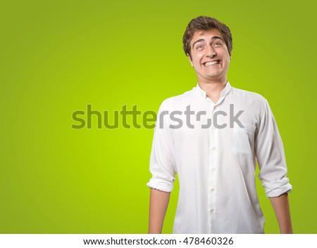 Crazy young man posing on green background