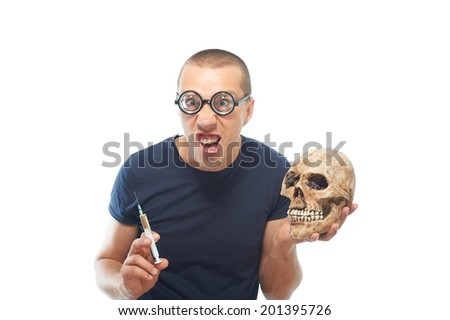 Crazy,young scientist in glasses holding syringe and skull - stock photo