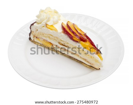 Cream cake with peach fruit on plate isolated on white - stock photo