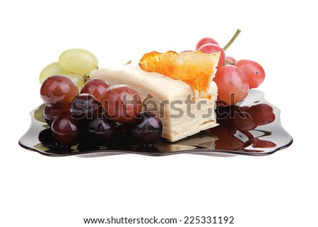 cream cheese cake and grapes on black - stock photo
