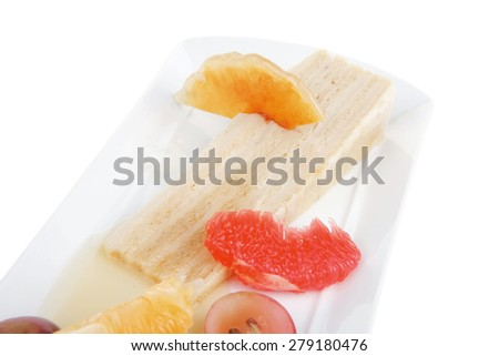 cream cheese cake with fruits on white