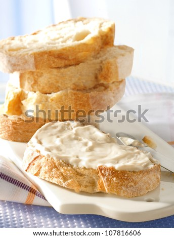 Cream cheese on sliced bread - stock photo