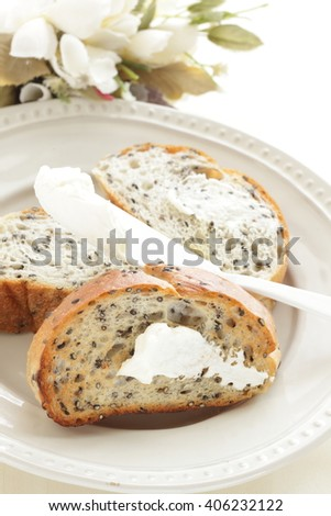 cream cheese on toasted sesame bread