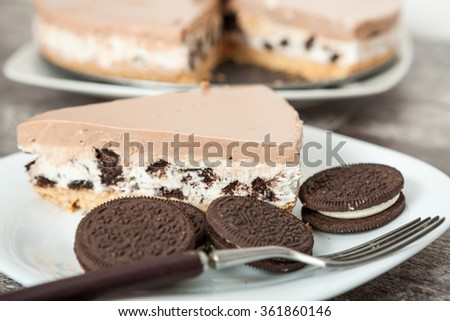 Cream cheesecake with cookies - stock photo