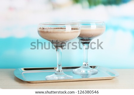 Cream cocktails on brightblue background - stock photo