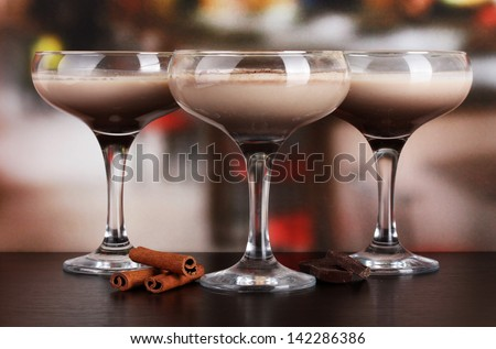 Cream cocktails on table in cafe - stock photo