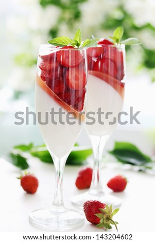 cream jelly with strawberries in a glass - stock photo