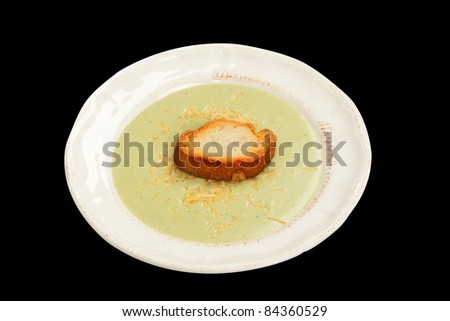 Cream leak soup with piece of toasted garlic bread