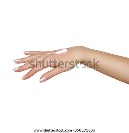 Cream on a female hand  - stock photo