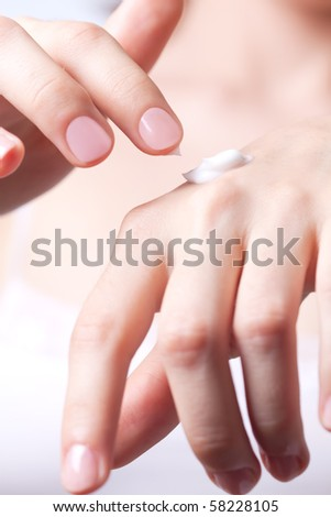 Cream on the women hand. - stock photo