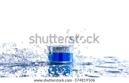 Cream pot  and water splash. Concept beauty and felling fresh - stock photo