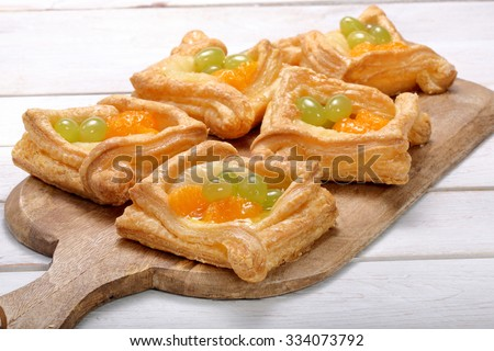 Cream puff pastry with fruit - stock photo