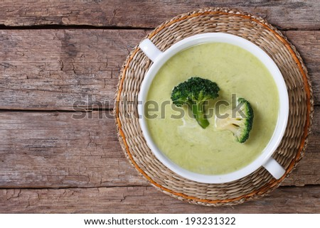 Cream soup of broccoli on the table close-up. horizontal top view  - stock photo