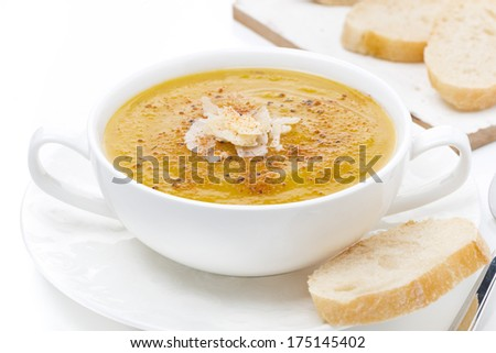 cream soup of yellow lentils with bread, close-up, isolated on white - stock photo