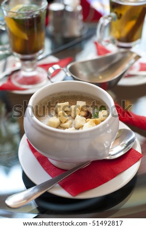 cream soup  with croutons  on the table  in cafe