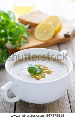 Cream soup with green lentil - stock photo