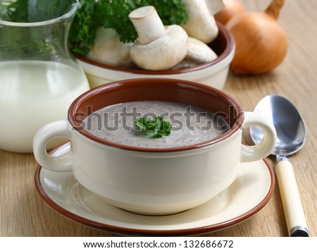 Cream soup with mushrooms, decorated parsley