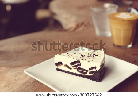 Creamy cheesecake with chocolate chocolate cookies and cream biscuits.  - stock photo