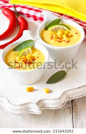 Creamy corn soup with lemon and sage. - stock photo