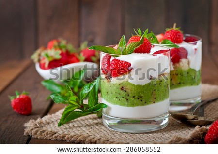 Creamy dessert with strawberries and kiwi - stock photo