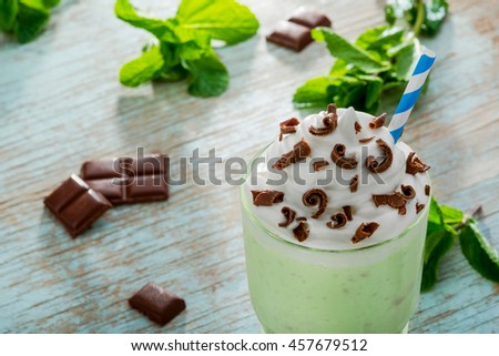 Creamy drink with fresh ingredients is the best idea for weather in summer. Mint with green apples for fresh feelings, chocolate chips and whipped topping for better and brighter taste. - stock photo